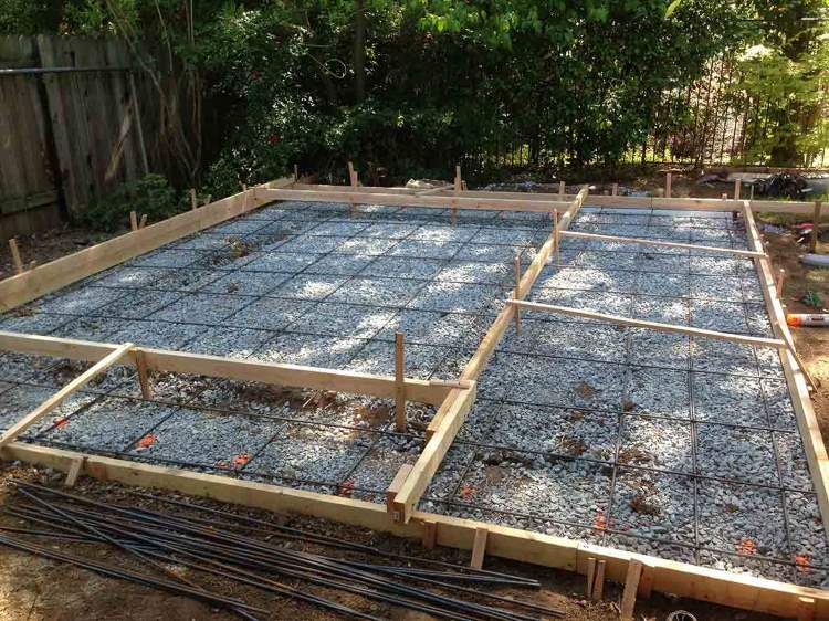 Initial wood form grid with two tier height, steel rebar mesh grid and small wood to create grooves in the patio area.