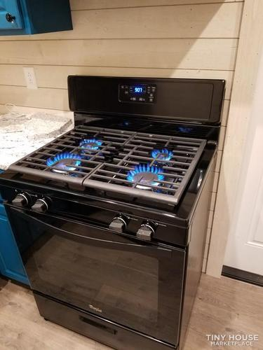 Gas stove with all four gas hobs currently on.