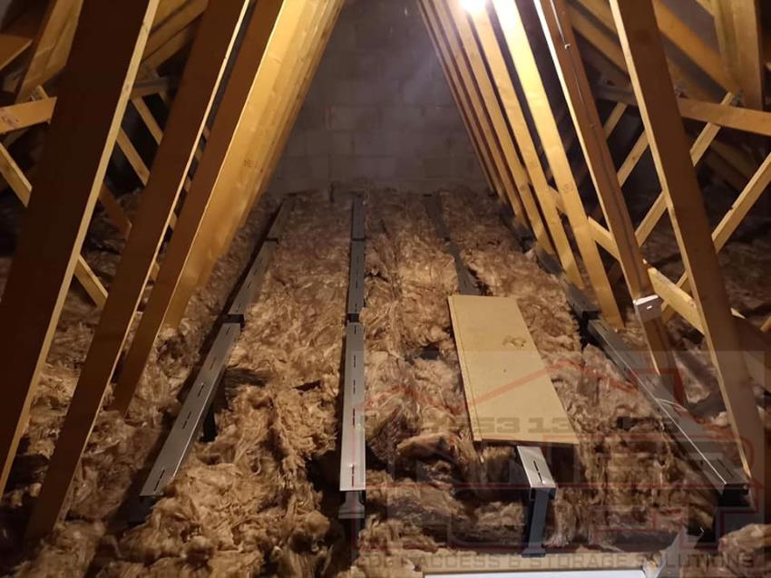 Metal loft strips which attach to roof timbers, raising the board height above the insulation level.