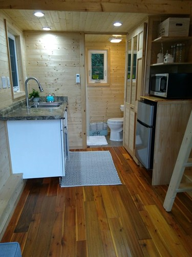 Another useful look at the whole downstairs, including kitchen area. This time with the bathroom door open.